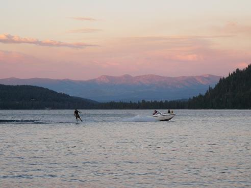 Waterskiing on Donner Lake at sunset in Truckee, California