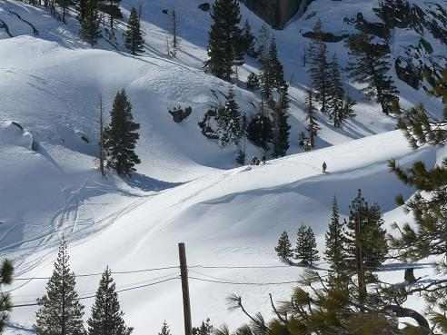 Snowboarders hiking up Shallenberger Ridge from Old Hwy 40 in Truckee, CA